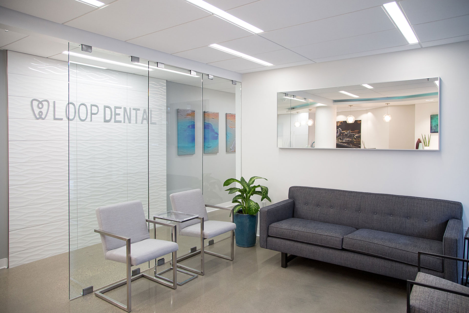 The Loop Dental logo hangs on a wall inside the Loop Dental office.
