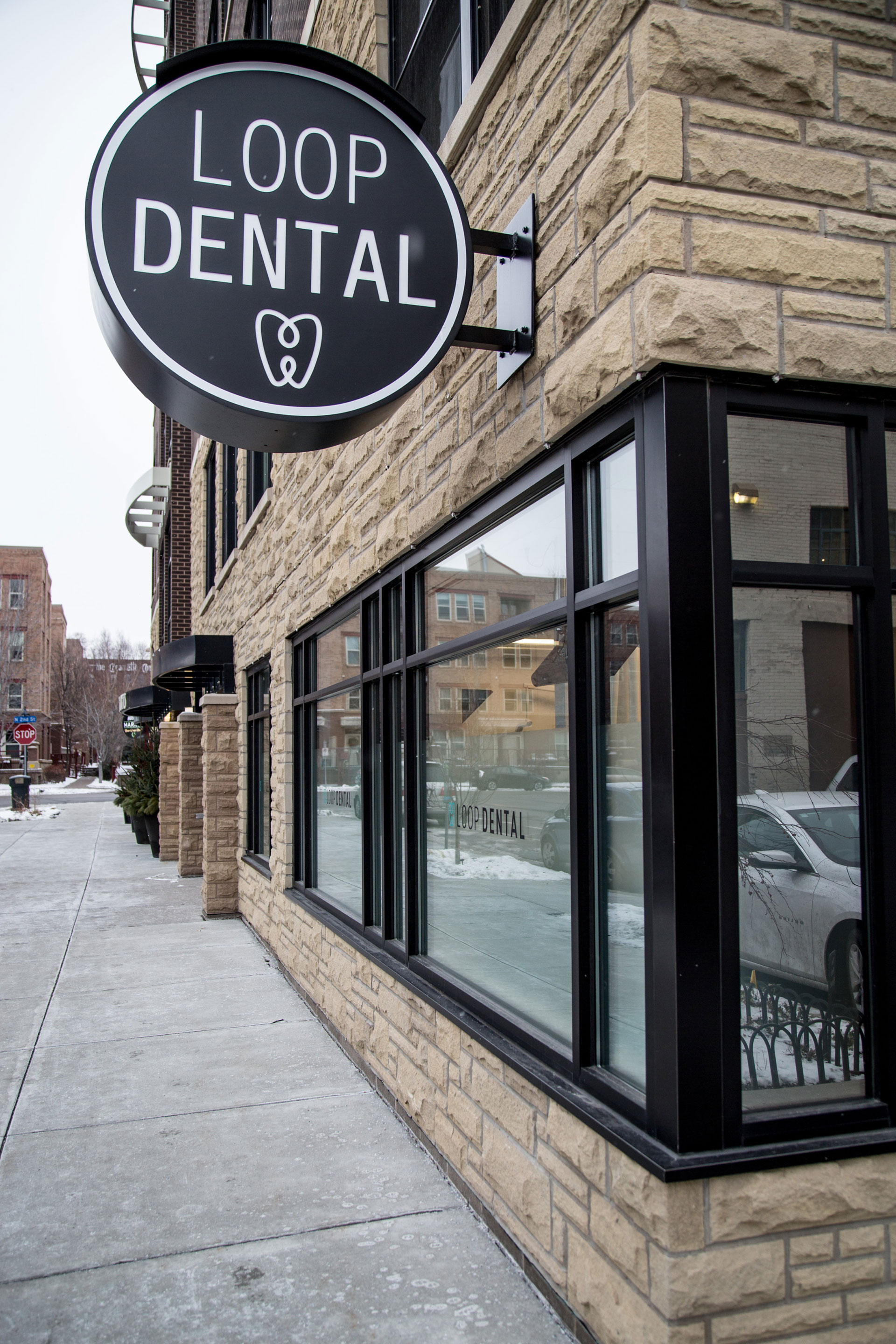 The sign for Loop Dental, a boutique dental practice in the North Loop, hangs proudly outside the office.